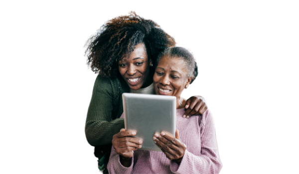 Adult daughter viewing an tablet device with her mother.