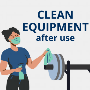 Woman in mask cleaning weight room equipment